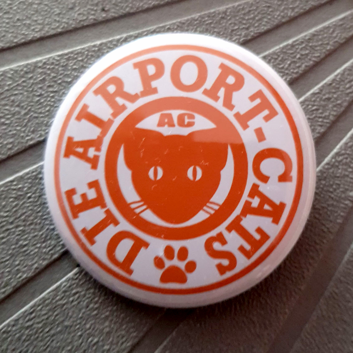 Button Airport-Cats Logo - Orange